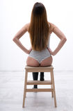 Sexy woman sitting on the wooden chair Stock Image