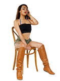 Sexy woman sitting in wooden chair issolated on white Royalty Free Stock Photography