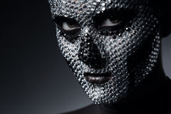 Sexy woman with skull face of rhinestones Royalty Free Stock Photography