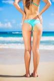 Sexy woman in small bikini on the beach Royalty Free Stock Photography