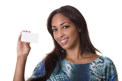 woman smiles with a blank busuness card. Royalty Free Stock Images