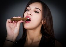 Sexy woman smokes cigar Stock Photo