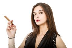 Sexy woman smokes cigar Royalty Free Stock Image