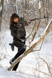 Sexy woman with a sniper rifle. Sexy young woman with a sniper rifle in winter forest Stock Image