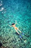 Woman snorkeling. Drone view of woman in bikini snorkeling in the blue sea royalty free stock images