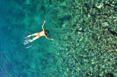 Sexy woman snorkeling in tropical sea. Sexy woman snorkeling in clear sea water Stock Image