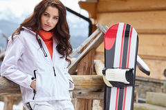 Sexy woman with snowboard outdoors . Stock Images