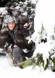 Woman in snowy winter outdoors. Beautiful and woman in snowy winter outdoors stock photography