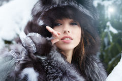 Sexy woman in snowy winter outdoors Royalty Free Stock Photos