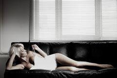 Sexy woman on sofa Royalty Free Stock Photo
