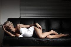 Sexy woman on sofa Royalty Free Stock Photos