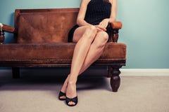 Sexy woman on sofa Royalty Free Stock Photo