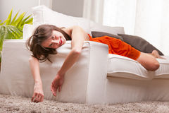 Sexy woman softly lying on a sofa Stock Photos