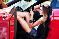 Sexy woman in sport car Stock Photos