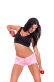 Sexy woman in sports with dumbbells exercising Royalty Free Stock Photography