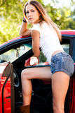 sexy woman stand by car  Stock Images