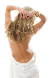 Sexy woman standing with a bare back. Sexy young woman standing with a bare back and beautiful hair. Isolated over white background Royalty Free Stock Images