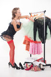 Sexy woman standing in front of a rack of clothes Stock Photo