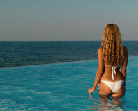 woman standing in infinity pool Stock Image
