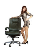 Sexy woman standing with  office armchair Stock Images
