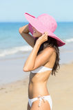 Sexy woman standing towards the sea in summer Stock Image