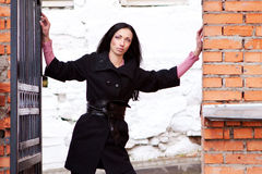 Sexy woman stands near the brick wall Royalty Free Stock Images