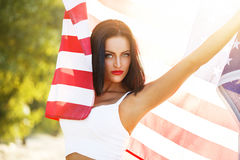 Sexy woman with star spangled banner outdoor Stock Photo