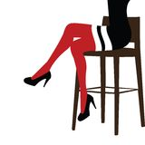 Sexy woman staying on a bar chair. Sexy woman legs staying on a bar chair Royalty Free Stock Photography
