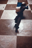 Sexy woman in stockings lyingon chess board type floor Stock Photos