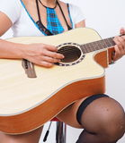 Sexy woman with stockings plays guitar Stock Image