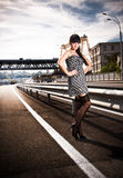Sexy woman in stockings standing on highway Royalty Free Stock Images