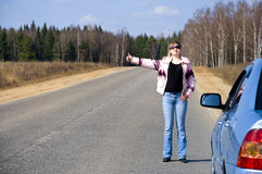 Sexy woman stopping car girl hitchhiking Stock Photography