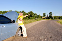 woman stopping car on the road stock photo