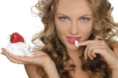 Sexy woman with strawberries and cream Stock Image