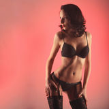 Sexy woman stripper dancing showgirl in studio pink background Royalty Free Stock Photography