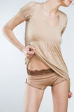 Sexy woman in stylish beige lingerie Royalty Free Stock Photography