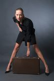 Sexy woman with suitcase Stock Photography