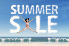 Sexy woman with summer sale cloud Royalty Free Stock Photos