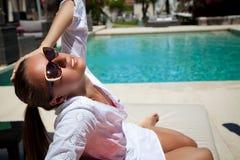 Sexy woman sunbathing at pool resort Royalty Free Stock Photo