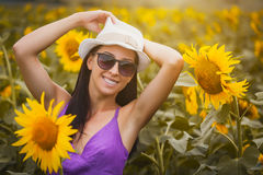 Sexy woman in a sunflower's field Royalty Free Stock Images