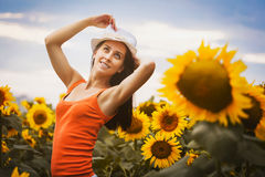 Sexy woman in a sunflower's field Royalty Free Stock Photography