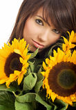 woman with sunflowers Stock Photo