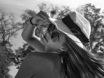woman in sunglasses and a hat. stock photo