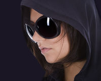 Sexy woman in sunglasses with hood. Stock Photography
