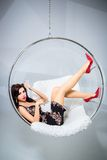 Sexy woman suspended from an aerial hoop Royalty Free Stock Images