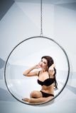 Sexy woman suspended from an aerial hoop Stock Images