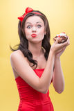 Sexy woman with sweets. Half-length portrait of happy beautiful dark-haired woman wearing great red headband holding tasty chocolate cake and taking pleasure in Royalty Free Stock Photography