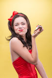 Sexy woman with sweets. Half-length portrait of happy beautiful dark-haired woman wearing great red headband holding tasty chocolate cake and taking pleasure in Royalty Free Stock Image