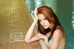 Sexy woman in a swimming pool Stock Photo