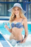 Sexy woman at swimming pool Stock Photo